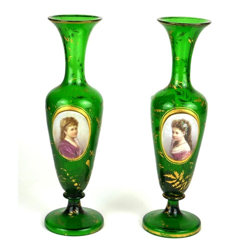 A pair of mid 19thC Bohemian green overlay baluster vases