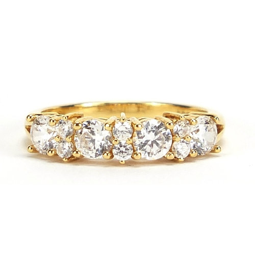 A 18ct gold cubic zirconia half eternity ring, size N, 3.5g