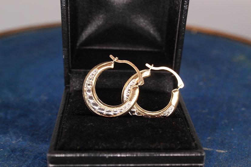 A pair of 9ct gold hoop earrings, weighing 0.8g