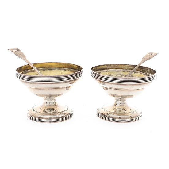 A pair of George III silver ogee circular salt cellars