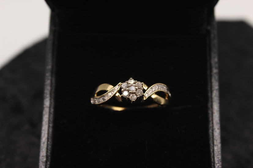 A 9ct gold diamond ring, size P, weighing 2.4g