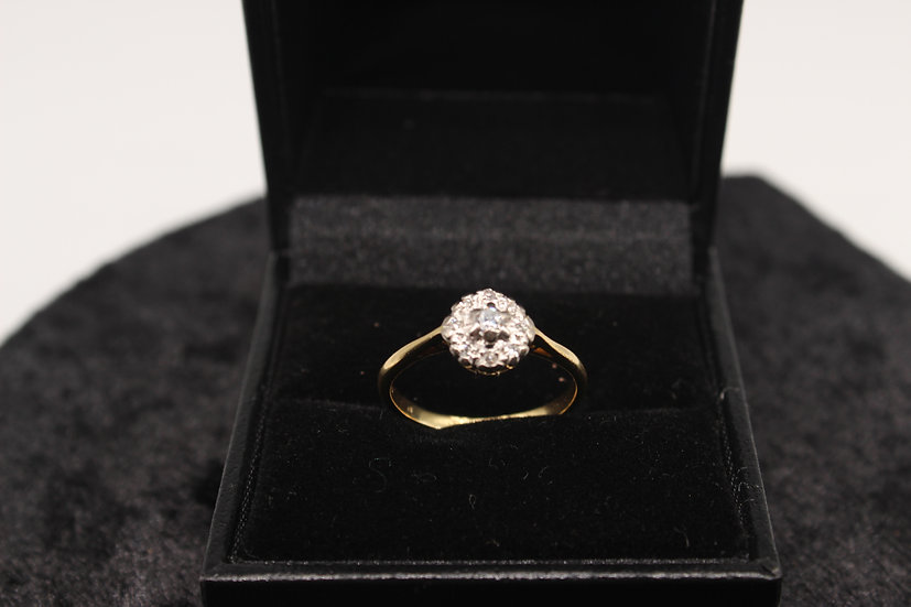 A 18ct gold diamond ring, size L, weighing 2.5g