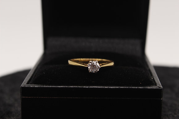 A 18ct gold diamond ring, size I, weighing 1.9g