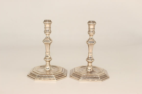 A pair of BM London silver candlesticks