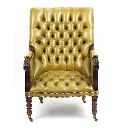 Regency style mahogany library chair with mustard leather button back upholstere