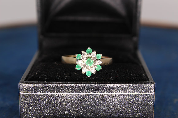 A 9ct gold, diamond & emerald ring, size M, weighing 2.7g