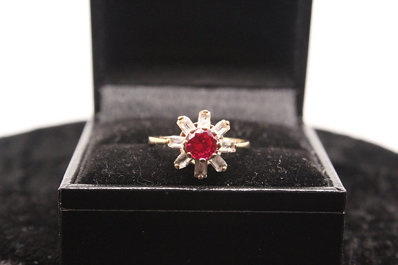 A 9ct gold and ruby ring, size L, weighing 2.3g