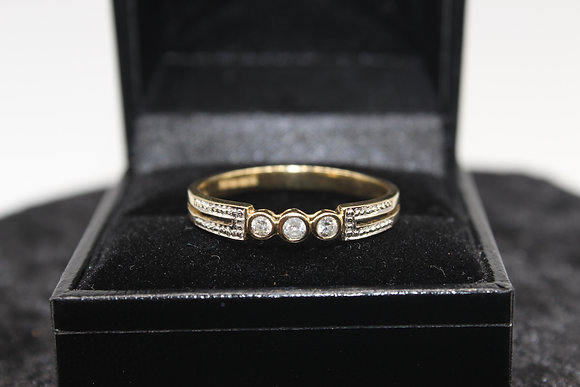 A 9ct gold diamond ring, size Q, weighing 2.6g