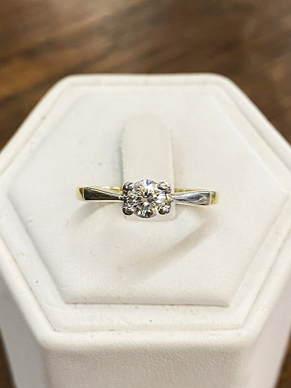 A 18ct two tone gold & 50 PTS diamond ring, size N, weighing 3.3g