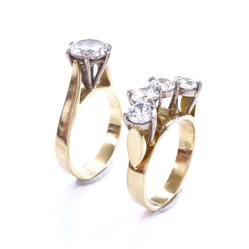 A modern 18ct gold CZ engagement set, size I, 8.9g total