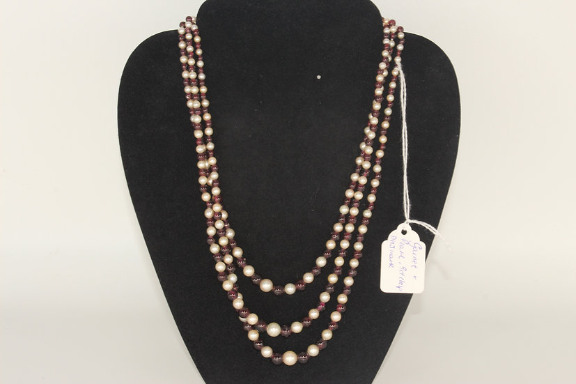 A garnet and pearl 3 string beaded necklace with a 9ct clasp marked 'DHJ'
