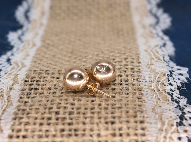 A pair of 9ct stud earrings, weighing 0.5g