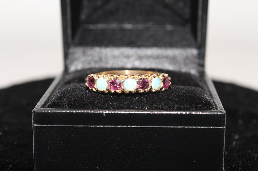 A 9ct gold and ruby ring, size S, weighing 2.2g