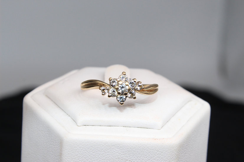 A 9ct gold ring, size T, weighing 2.1g