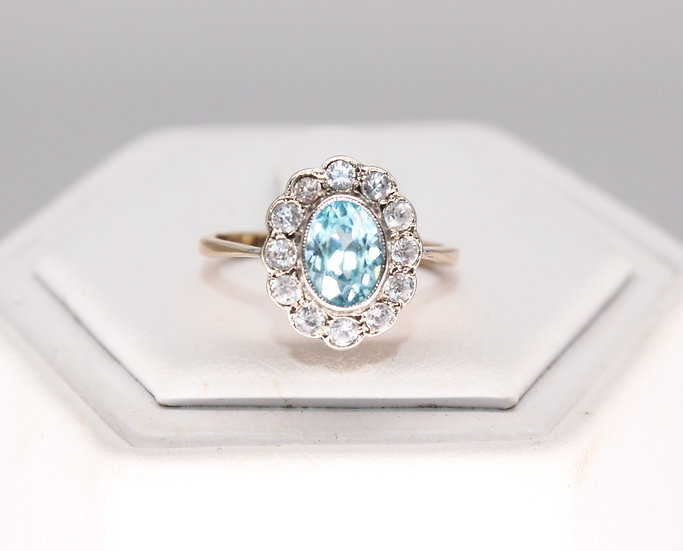 A 9ct gold ring, size K, weighing 2.3g