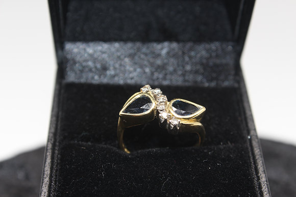 A 18ct gold, sapphire & diamond ring, size I, weighing 4.7g