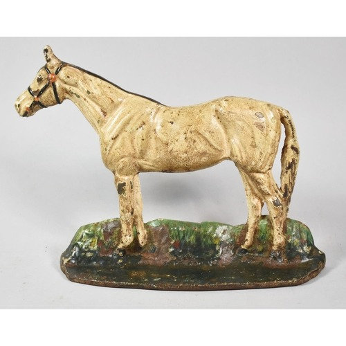 An Early 20th Century Painted Cast Metal Doorstop in the Form of a Horse