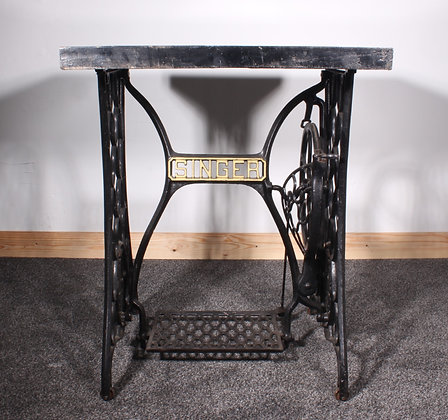 A granite topped SINGER side table
