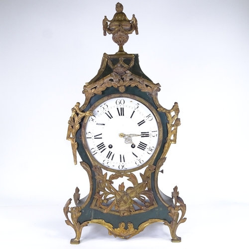 A large 19th century French green painted wood and brass 8-day mantel clock