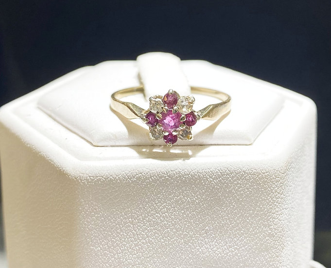 A 9ct gold, diamond & ruby ring, size P, weighing 1.4g