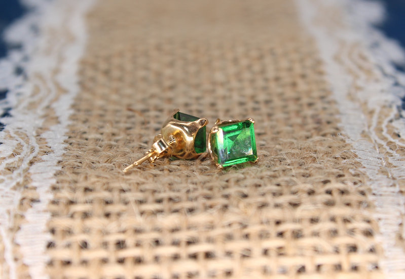 A pair of 9ct gold earrings, weighing 0.4g