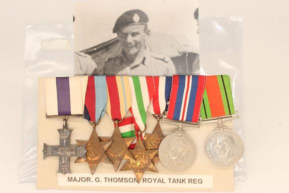A 7 medal set awarded to Major G.Thomson Royal Tank Reg MC who belonged to the 6