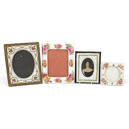 Four porcelain photo frames including three easel examples