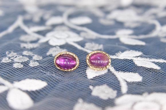 A pair of 9ct earrings, weighing 0.6g