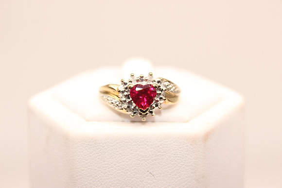 A 9ct gold and ruby ring, size P, weighing 2.6g