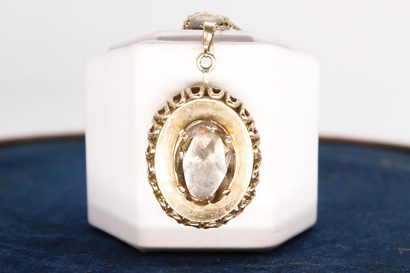 A large 9ct gold smoky quartz pendant on a 9ct gold necklace