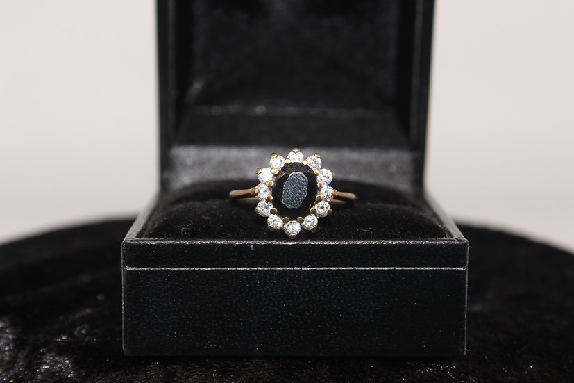 A 9ct gold and topaz ring, size K, weighing 2.2g