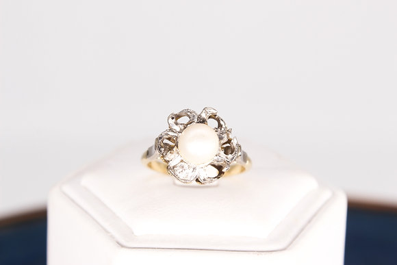 A 18ct gold pearl ring set with a diamond, size N/O, weighing 4.7g