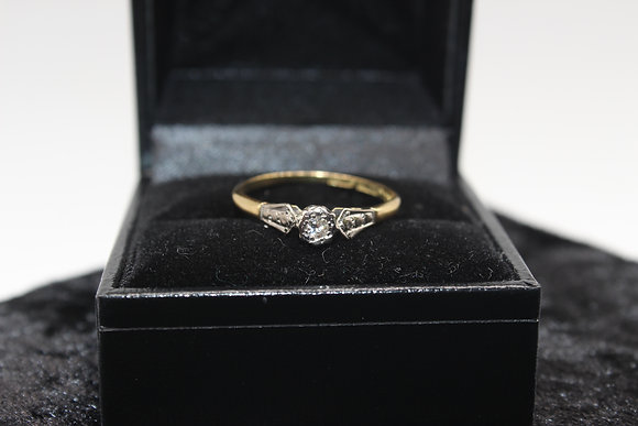 A 18ct gold diamond ring, size Q, weighing 2g