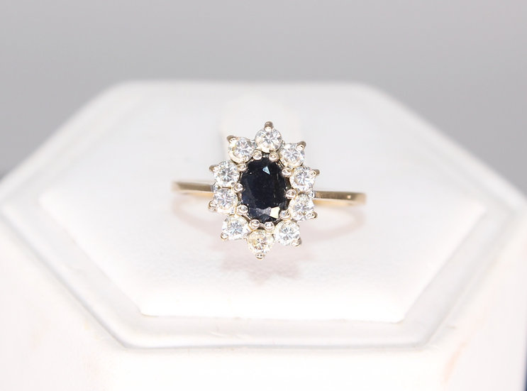 A 9ct gold, Topaz and CZ ring, size M, weighing 1.7g
