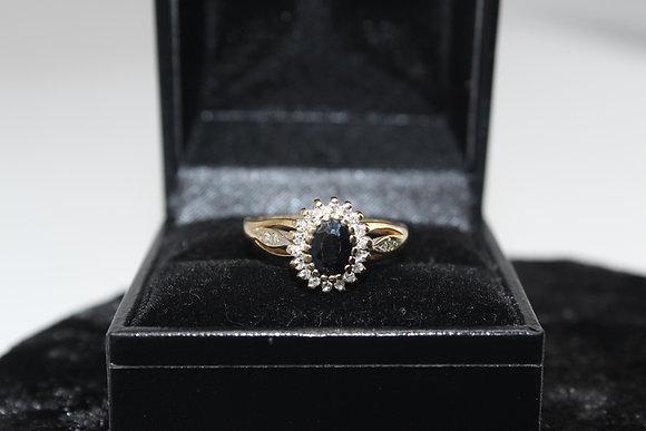 A 9ct gold, diamond & sapphire ring, size Q