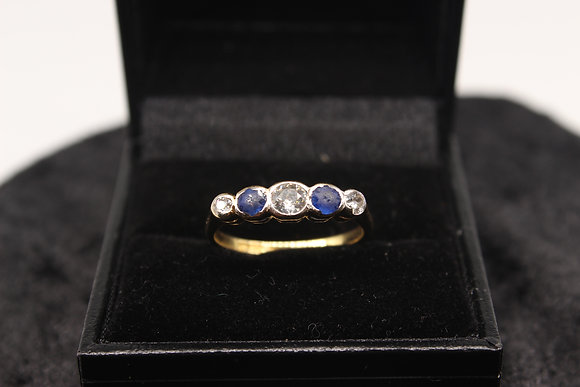 A 18ct gold, diamond & sapphire ring, size O, weighing 2.8g