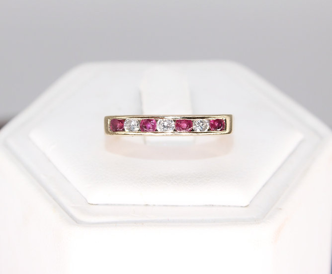 A 9ct 15 PTS Ruby & 10 PTS diamond gold ring, size N, weighing 2.4g