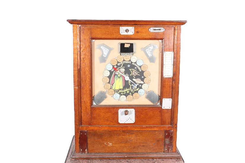 A 1930/50's oak cased coin operated fortune teller machine