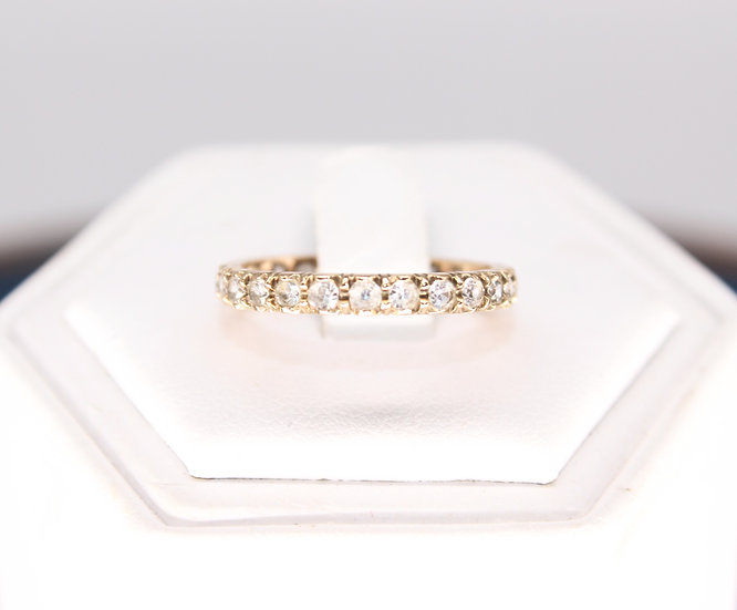 A 9ct full eternity ring, size O, weighing 1.7g