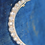 Thumbnail: A diamond crescent brooch set with 13 old cut diamonds