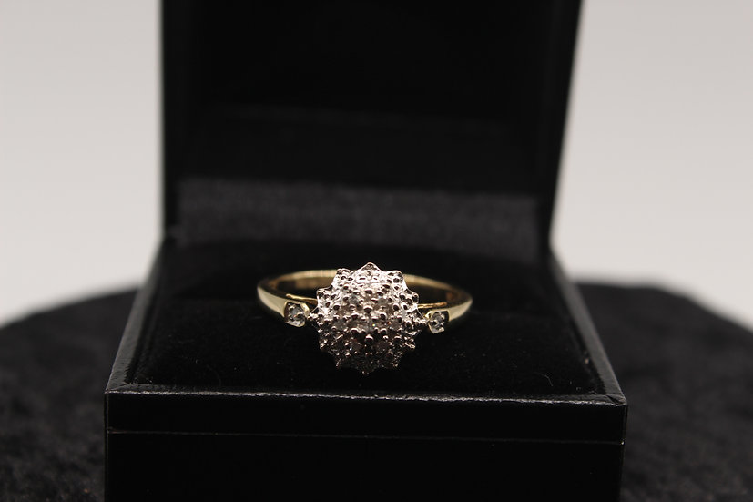 A 9ct gold diamond ring, size R, weighing 2.5g