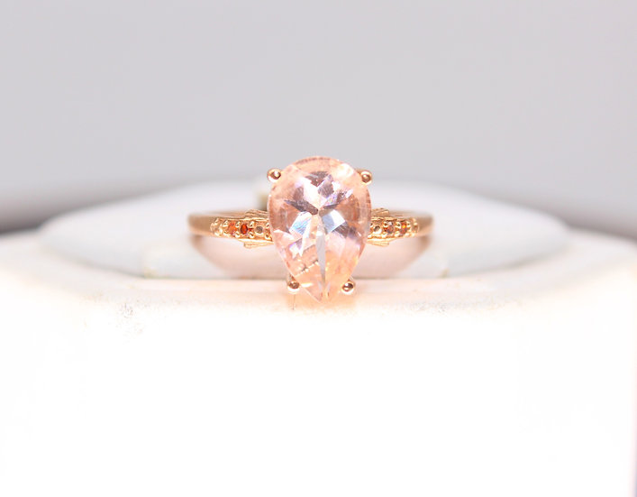 A 9ct rose gold ring, size J, weighing 1.7g