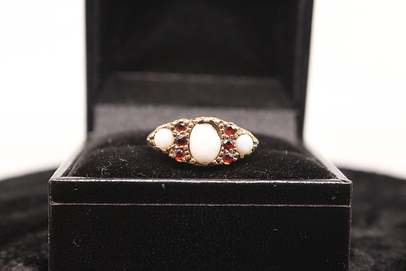 A 9ct gold ring, size L, weighing 3.1g