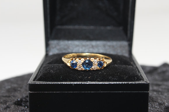 A 18ct gold, diamond & sapphire ring, size U, weighing 2.6g