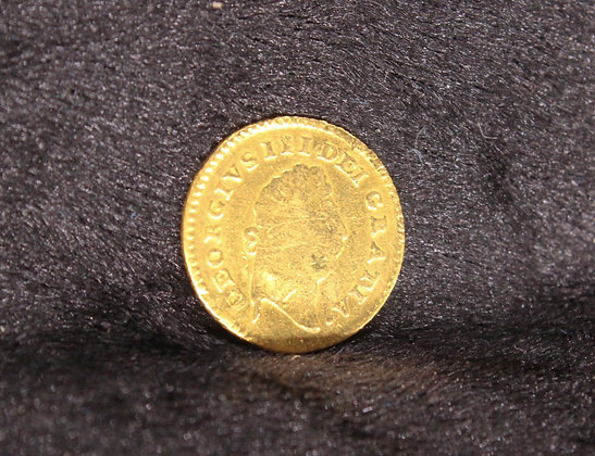 A George III 1798 gold third Guinea.