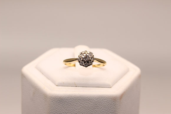 A18ct gold and diamond ring, size O, weighing 2.0g