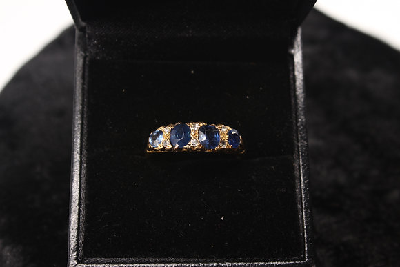A 18ct gold, diamond & sapphire ring, size Q, weighing 2.8g