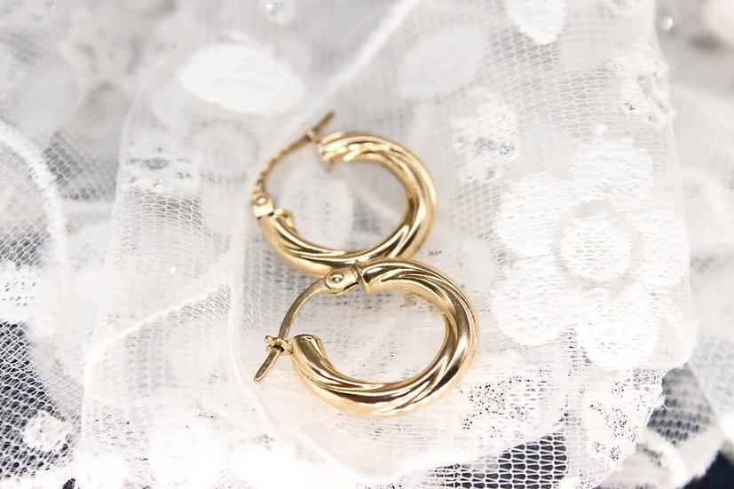 A pair of 9ct hoop earrings, weighing 1.1g
