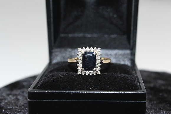 A 9ct gold, diamond & sapphire ring, size P, weighing 3.2g