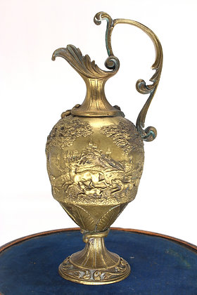 Classical bronzed ewer cast in relief with a hunting scene